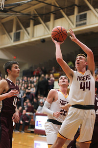 Chris Martin for The Herald Bulletin Alexandria's Dane Hueston drives in for a layup Friday night at home against Wes-Del