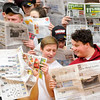 Don Knight | The Herald Bulletin<br /> Alexandria students show their disinterest in Frankton's starting five by pretending to read the newspaper as the Tigers hosted the Eagles on Friday. Read about the game in today's Sports section.