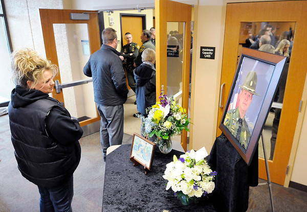 Don Knight | The Herald Bulletin<br /> The line for Conservation Officer Ed Bollman's visitation stretched out the door at Madison Park Church of God as hundreds turned out to honor his memory on Friday.