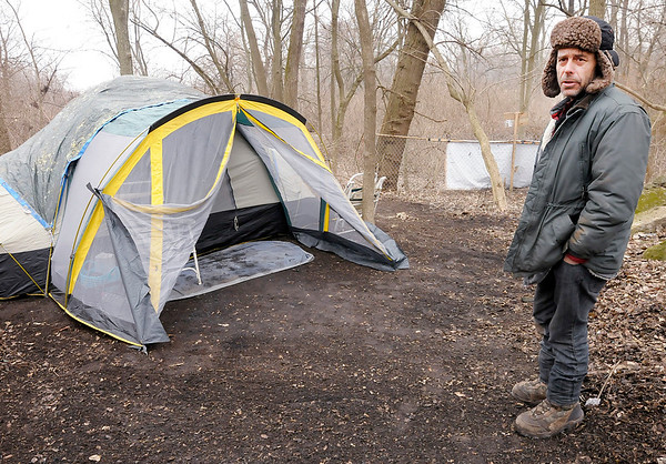 Don Knight | The Herald Bulletin<br /> Nick Pancol stands on his property south of the White River. Homeless Pancol started living on the property, when his sisters found out they purchased the land for him. Now he tries to help other homeless people.