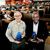 John P. Cleary | The Herald Bulletin<br /> Ted Tap, property manager Mounds State Park, and Bill Watson, owner of The Pitt BBQ & Grill, were recipients of the President's Award and Outstanding Community Volunteer Award respectively during the Anderson Madison County Visitors Bureau annual luncheon Thursday at  Hoosier Park Racing & Casino Thursday.