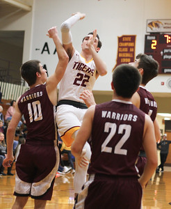 Chris Martin for The Herald Bulletin Alexandria's Austin Paddock drives in for a contested jump shot Friday night at home against Wes-Del.