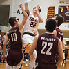 Chris Martin for The Herald Bulletin<br /> Alexandria's Austin Paddock drives in for a contested jump shot Friday night at home against Wes-Del.