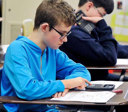 John P. Cleary | The Herald Bulletin<br /> Alexandria-Monroe sixth grader Lukas Sullivan takes a pre-calculus test in Krystal Hill's Alexandria-Monroe Jr.-Sr. math class this past week.