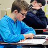 John P. Cleary | The Herald Bulletin<br /> Alexandria-Monroe sixth grader Lukas Sullivan takes a pre-calculus test in Krystal Hill's Alexandria-Monroe Jr.-Sr. math class this past week.
