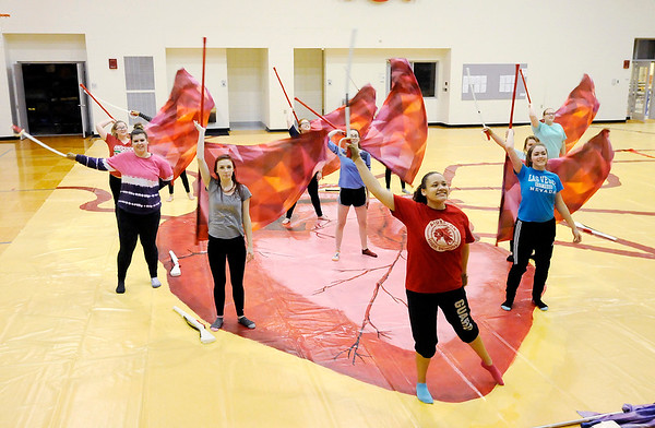 Don Knight | The Herald Bulletin<br /> The Anderson High School Winter Guard practices their routine Elastic Heart at Erskine Elementary on Wednesday. Anderson is hosting their Festival of Colors Winter Guard contest on February 17th.