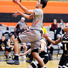Don Knight | The Herald Bulletin<br /> Anderson University's Stanley Duncan drives for a layup as the Ravens hosted Manchester on Wednesday.