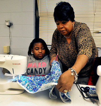 John P. Cleary | The Herald Bulleti<br /> Aeryiyona Boyd,12, gets assistance from Ceatrice Bostic, coordinator of the sewing program at the Trustee's Boys and Girls Club, during a recent session.