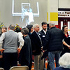 "John P. Cleary | The Herald Bulletin<br /> Family members of Orvis ""Shorty"" Burdsull greet friends during visitation hours Saturday afternoon as photos of Shorty's life are projected in the background  in the Alexandria Intermediate School gym."