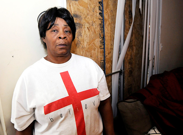 Don Knight | The Herald Bulletin<br /> Frannie Steen stands in front of the boarded up patio door that was damaged when police searched her apartment at The Courtyard Apartments last Thursday.