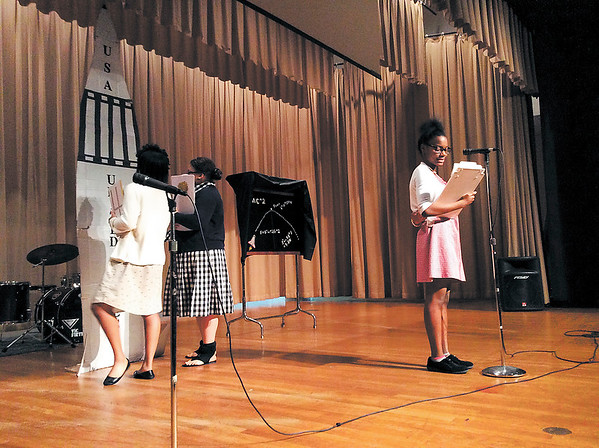 Three youth center participants recreate the roles of NASA computers Kathryn Johnson, Dorothy Bond and Mary Jackson.