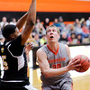 Don Knight | The Herald Bulletin<br /> Anderson University's Cole Hartman looks to shoot as the Ravens hosted Manchester on Wednesday.