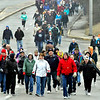 "John P. Cleary | The Herald Bulletin<br /> Participants in The Christian Center's annual ""Walk a Mile in My Shoes"" fund raiser work their way along University Blvd. toward the Truman Bridge Saturday morning as they walk to The Christian Center from AU."