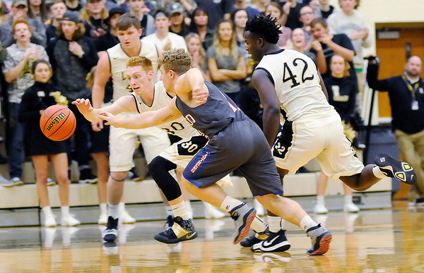 Don Knight | The Herald Bulletin<br /> Lapel's Austin Lyons and Elwood's Jake Wilson chase after a loose ball during the first round of the sectional at Lapel on Tuesday.