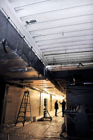 John P. Cleary | The Herald Bulletin<br /> The flooring and ceiling have be removed, and the walls encapsulated in plastic on the third floor of the Madison County Government Center in preparation of the start of removing the asbestos which can be seen in the upper foreground.