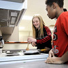 Don Knight |  The Herald Bulletin<br /> Joselyn Eldridge and Rasar Newsom cook ground beef for sloppy joes during Highland Middle School's after school cooking club.