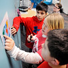 John P. Cleary | The Herald Bulletin<br /> Ethan Wilson, 11, Khristopher Coy, 9, and Leland Hernandez, 9, work together to find clues that will open all the locks on a box during Anderson Public Library's We are Readers - Breakout activity Tuesday in the Children's Department. The Escape Room type activity for children is inspired by Lauren Castillo's collection of picture books.