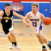 John P. Cleary | The Herald Bulletin<br /> Elwood's Jake Wilson gets a step on Cowan's Noah Harrington as he drives into the lane.