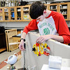 Don Knight | The Herald Bulletin<br /> Simon Bell works on reseting the Rube Goldberg machine built by Anderson High School Students. The machine pours a bowl of cereal in 73 steps.