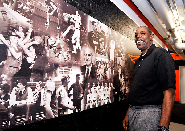 John P. Cleary | The Herald Bulletin<br /> Jeff Howard looks over the mural outside the locker rooms of OC Lewis Gym at Anderson University that depict the history of the school's program that includes Howard.