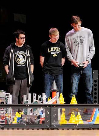 Don Knight | The Herald Bulletin<br /> Lapel's robotics club competes in the VEX Robotics competition hosted by Anderson University's Science and Engineering. From left are Parker Champney, Joey Stern and Joseph Conrad.