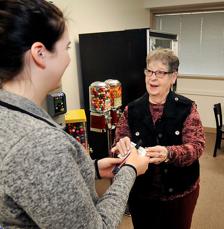 John P. Cleary | The Herald Bulletin<br /> Primrose Retirement Communities observe Random Acts of Kindness Day by handing out gift cards and hand sanitizer pens to students at Ivy Tech at the 53rd Street campus.