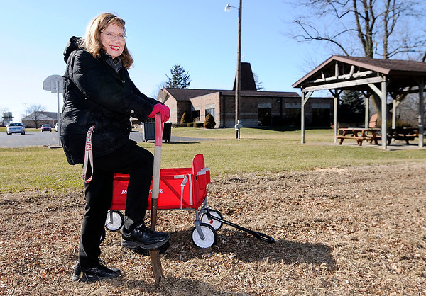 Don Knight | The Herald Bulletin<br /> Organizing and working in the community garden at St. John Lutheran Church is just one of several ways Kay Marcuson volunteers in her community.