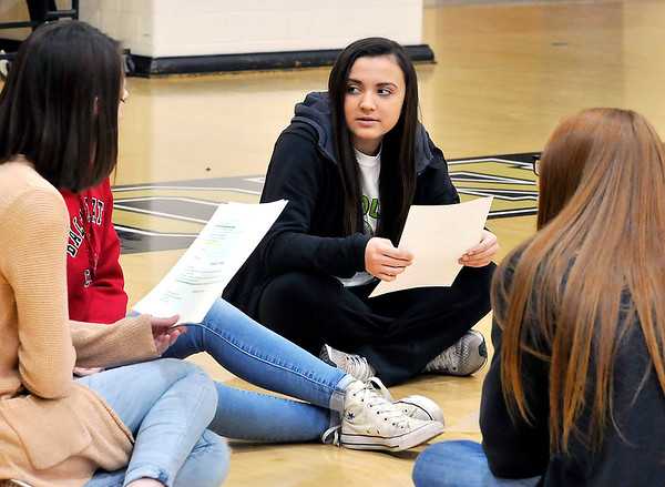 John P. Cleary | The Herald Bulletin<br /> Madison-Grant High School senior Maddison Evans works with some of her classmates in Pam Richards' fourth-year Spanish class as they rehearse short Fairy Tail plays, all in Spanish, that they will present to elementary students as a class project.