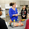 Don Knight |  The Herald Bulletin<br /> Math teacher Melissa Tucek gives her students directions before they make homemade sloppy joes during Highland Middle School's after school cooking club.