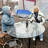 "Don Knight | The Herald Bulletin<br /> Rebecca Sheets and Sherri Everitt sit at a table at ""Nick's on the River"" while trying to stay warm on a cold day."