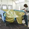 John P. Cleary | The Herald Bulletin<br /> Riley & Sons Collision Repair voted Best Body Shop. Here Mark Rick tapes up this truck bed preparing it for painting.