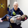 John P. Cleary | The Herald Bulletin<br /> This firefighter carries this child to the triage area during an active shooter training session Monday evening held at Lone Oak Wesleyan Church for the Lapel and Edgewood police and fire departments.