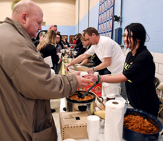 John P. Cleary | The Herald Bulletin<br /> Gino Travine gets a cup of chili from Lona Hill of the Stepping Stones team entry at the Walk For Hope Addiction Awareness Chili Cook-Off Saturday held at the UAW Hall.
