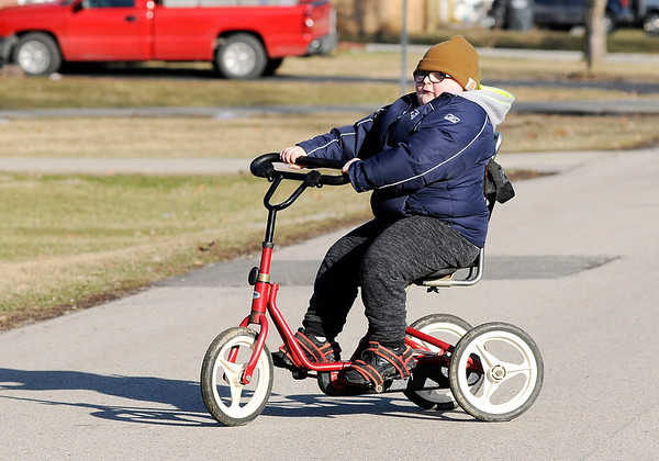 Don Knight | The Herald Bulletin The cold weather didn't stop Trenton Brown who was excited to ride his Rifton Adaptive Tricycle.