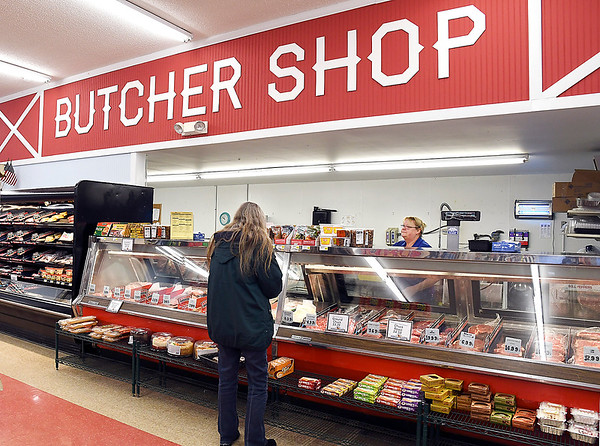 John P. Cleary | The Herald Bulletin<br /> Harvest Market was voted Best Grocery Store Meat Department.<br /> Teresa McCracken waits on a customer at the 8th & Scatterfield store.