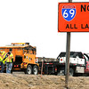 John P. Cleary | The Herald Bulletin<br /> Patching crews worked filling potholes Wednesday afternoon along northbound I-69 through the Anderson area after numerous reports of flat tires that were caused by vehicles hitting them.