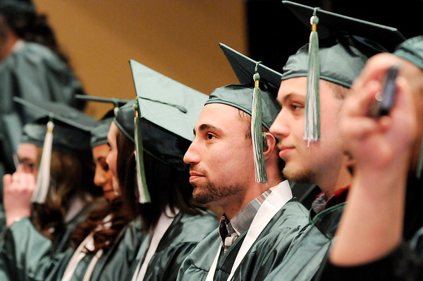Don Knight | The Herald Bulletin<br /> James Jones sits with his fellow graduates during the Excel Center's graduation at the Anderson City Building on Friday.