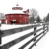 John P. Cleary | The Herald Bulletin<br /> A fresh five inches of snow makes for a picturesque scene for this red barn, horses, and wooden fence along Donnelly Road, east of CR 300 East Friday morning.