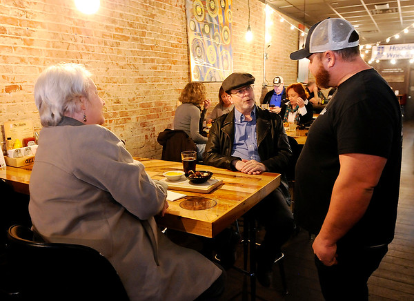 Don Knight   The Herald Bulletin<br /> Adam Croft talks to customers Randall and Lucetta Woodruff at The Stable in Pendleton.