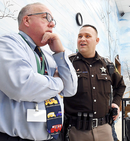 John P. Cleary | The Herald Bulletin<br /> Madison County Sheriff's DARE officer Darren Dyer, right, talks with Maple Ridge Elementary School principal John Lord.