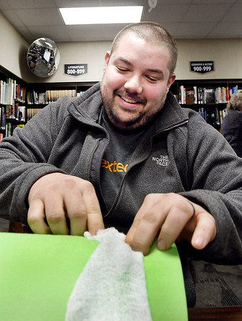 John P. Cleary | The Herald Bulletin<br /> Madison-Grant Jr.-Sr. High Schoo teacher TJ Herniak practices packing a wound with gauze as school staff members were being trained on using trauma kits Monday by Community Hospital Anderson.