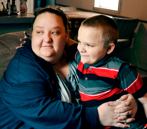 John P. Cleary   The Herald Bulletin<br /> Amber LeJeune, with her eight-year-old son Dylan, claims he was physically assaulted by three staff members of Frankton Elementary School.