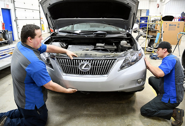 John P. Cleary   The Herald Bulletin<br /> Riley & Sons Collision Repair voted Best Body Shop.<br /> Brandon West and Jay Randolph re-attach the front end of this vehicle.