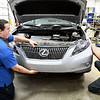 John P. Cleary | The Herald Bulletin<br /> Riley & Sons Collision Repair voted Best Body Shop.<br /> Brandon West and Jay Randolph re-attach the front end of this vehicle.