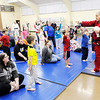 Don Knight | The Herald Bulletin<br /> Ed Leonard teaches a free children's safety program at the Mill Creek Civic Center on Wednesday. The class uses role playing and the instruction of a few self defense moves to help children escape a possible abduction.