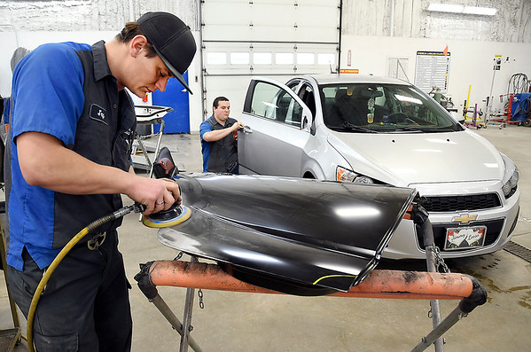 John P. Cleary | The Herald Bulletin<br /> Riley & Sons Collision Repair voted Best Body Shop.<br /> Jay Randolph works on this replacement rear door as Brandon West checks the alignment of the front door of this vehicle in the Riley & Sons Collision Repair body shop in Anderson.
