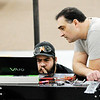 Don Knight | The Herald Bulletin<br /> Paul Nurkkala, left, and Pete Bitar troubleshoot the VertiCycle at Flagship East on Tuesday.