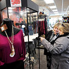 Don Knight | The Herald Bulletin<br /> Gaither Family Resources co-manager Sherry Cain, left, talks to Barb Austin about jewelry on display at the store on Friday. Everything in the store is marked down 50 percent and anything left over when the store closes will be donated to charity.