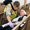 John P. Cleary | The Herald Bulletin<br /> This emergency medical person checks this victim for the extent of his injuries during the triage process during an active shooter training session Monday evening held at Lone Oak Wesleyan Church for the Lapel and Edgewood police and fire departments.