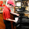 Don Knight | The Herald Bulletin<br /> Delivery driver Blake Messer places a pizza in his delivery bagat the <br /> Pizza King on Nichol Avenue.  Pizza King was voted as the best pizza in Madison County by readers of The Herald Bulletin.